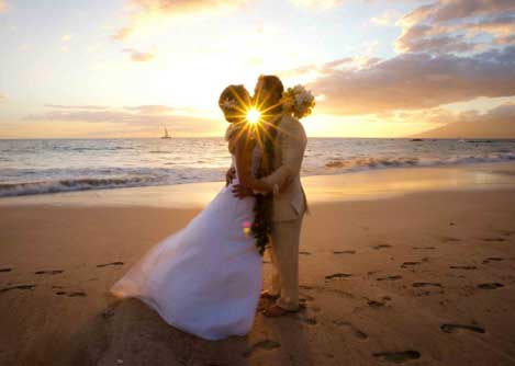 bridal couple on the beach at sunset